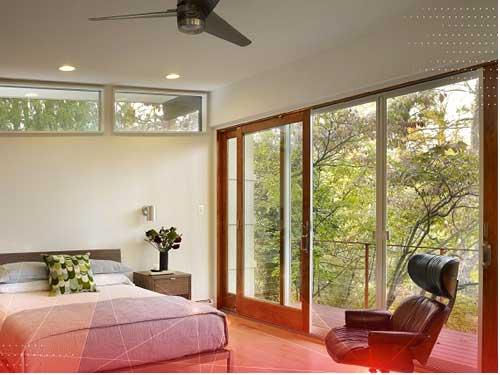 Mẫu cửa nhôm kính phòng ngủ vân gỗ trượt lùa