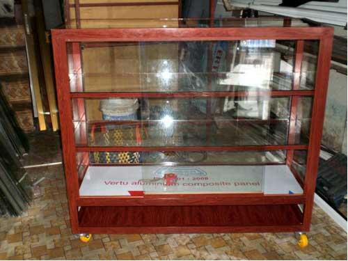 Mẩu tủ nhôm kính bán hàng màu giả gỗ