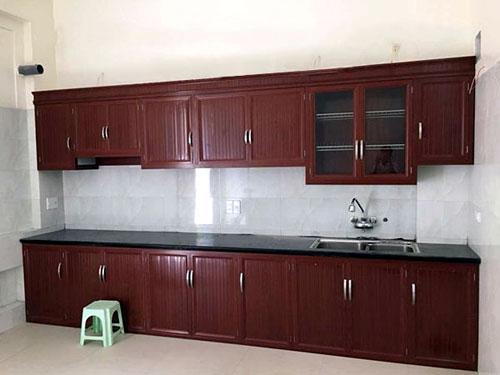 Thi công tủ bếp nhôm kính giả gỗ theo yêu cầu